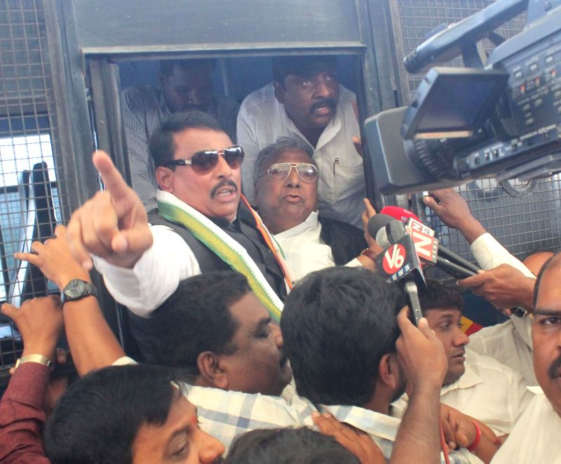 Police takes away Congress leaders demonstrating against the central government's decision to rename the domestic terminal at Shamshabad airport as NT Rama Rao domestic terminal in ... - Rao