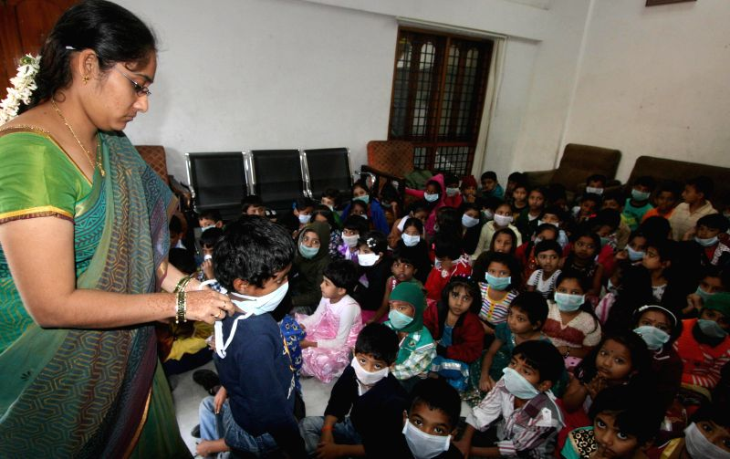 Protective masks being distributed in a Hyderabad school as a preventive measure against swine flu, on Jan 25, 2015.
