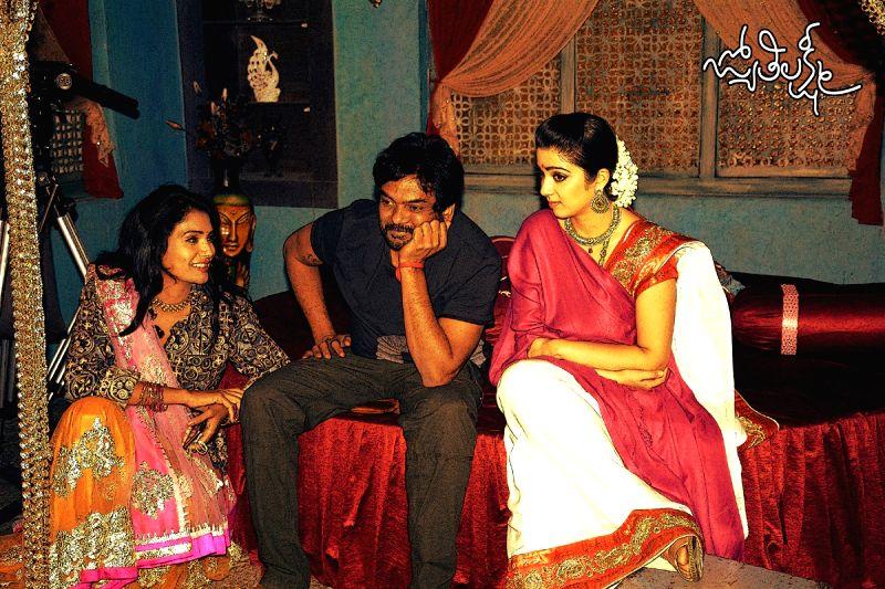 Puri Jagannath`s Telugu movie Jyothi Lakshmi`s *Working Stills*.