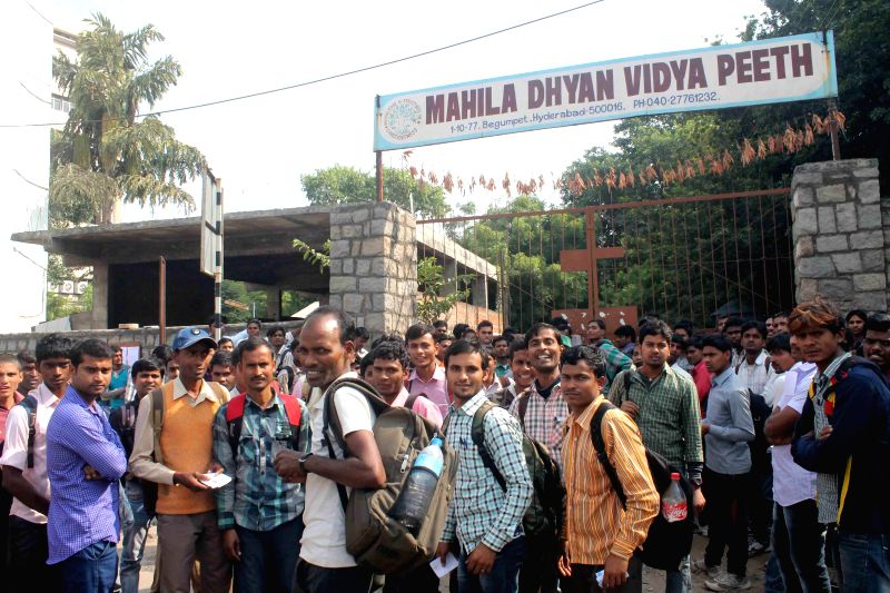 Railway job aspirants arrive to submit their application form in Hyderabad on Nov 23, 2014.