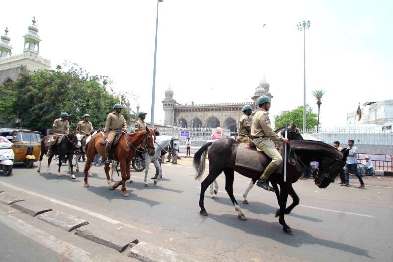 Security beefed-up near Charminar as a group of angry protesters pelted stones on them in Hyderabad on April 10, 2015.