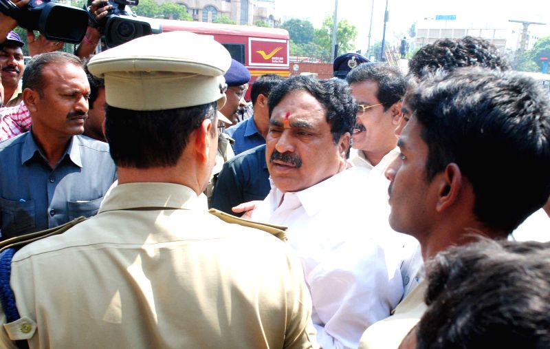 Security personnel take away TDP legislators who were earlier suspended from the Telangana assembly for the entire budget session in Hyderabad, on March 26, 2015.