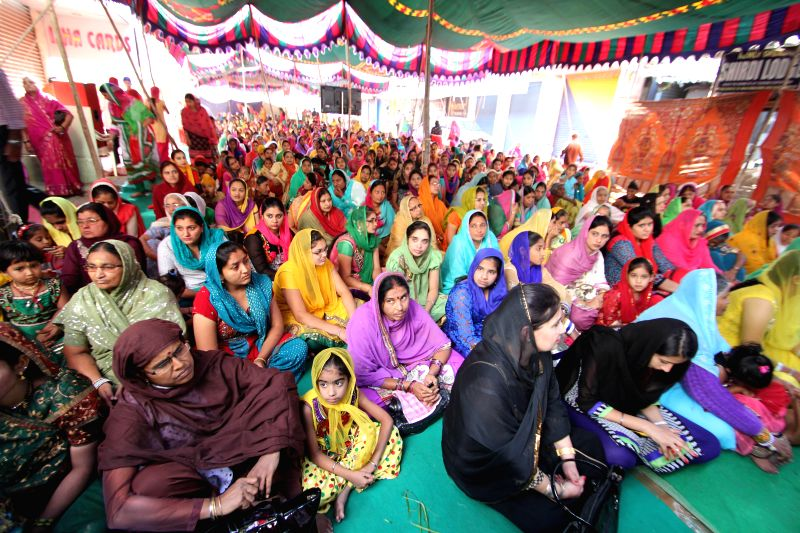 Sikhs participate in 350th birth anniversary celebrations of Guru Gobind Singh at the Central Gurudwara Gowliguda in Hyderabad, on Dec 28, 2014.