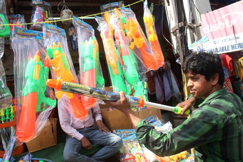 Small time businessmen setup their stalls ahead of Holi in Hyderabad  on March 3, 2015.