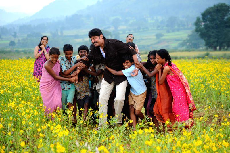 Stills from Telugu film `Hithudu`.
