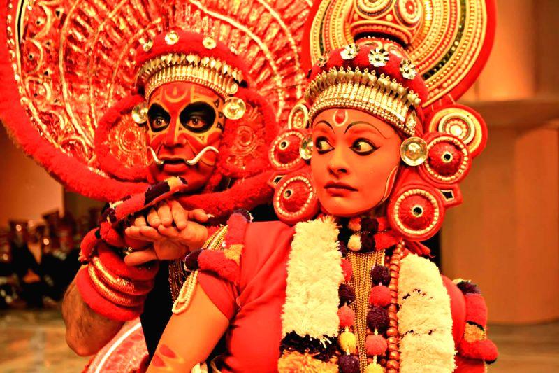 Stills from Telugu film `Uttama Villain`.