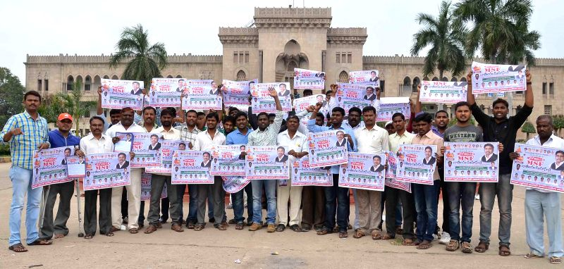 Students stage a demonstration in front of Arts College in Hyderabad on Dec 11, 2014.