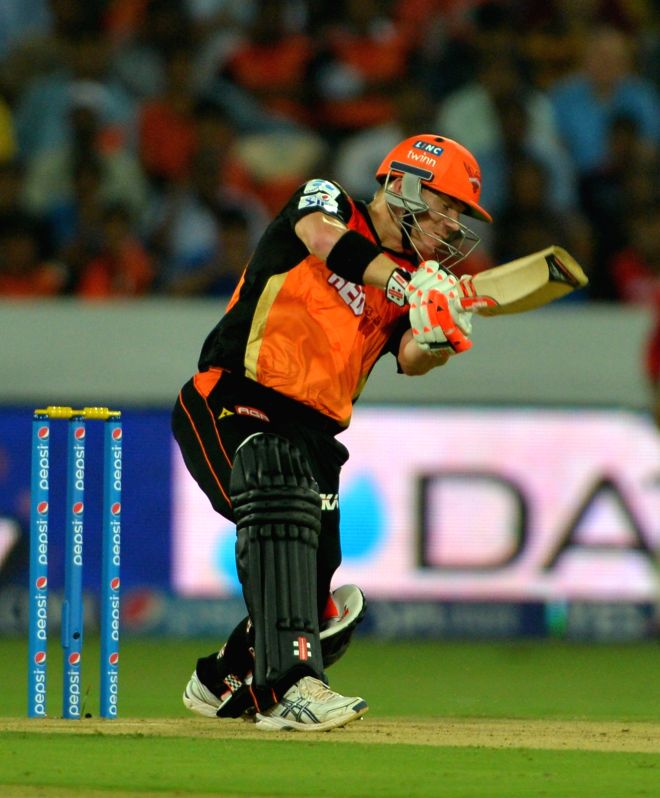Hyderabad : Sunrisers Hyderabad batsman David Warner in action during an IPL 2015 match between Sunrisers Hyderabad and Kings XI Punjab at the Rajiv Gandhi International Cricket Stadium in Hyderabad ... - David Warner