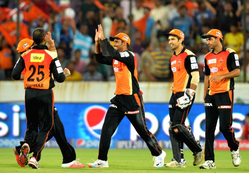 Sunrisers Hyderabad players celebrate fall of a wicket during an IPL-2015 match between Chennai Super Kings and Sunrisers Hyderabad at Rajiv Gandhi International Stadium, Uppal in ...