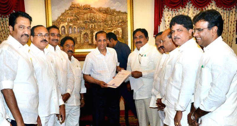 Suspended TDP legislators led by E. Dayakar Rao call on Telangana Governor ESL Narasimhan in Hyderabad, on March 13, 2015. - E. Dayakar Rao