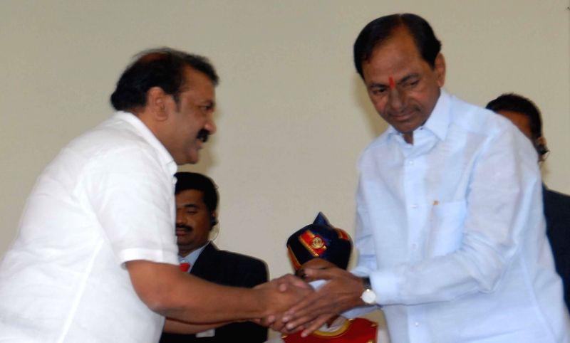 T. Srinivas Yadav with Telangana Chief Minister K Chandrasekhar Rao after swearing-in as a Telangana Minister in Hyderabad, on Dec 16, 2014. - K Chandrasekhar Rao and T. Srinivas Yadav