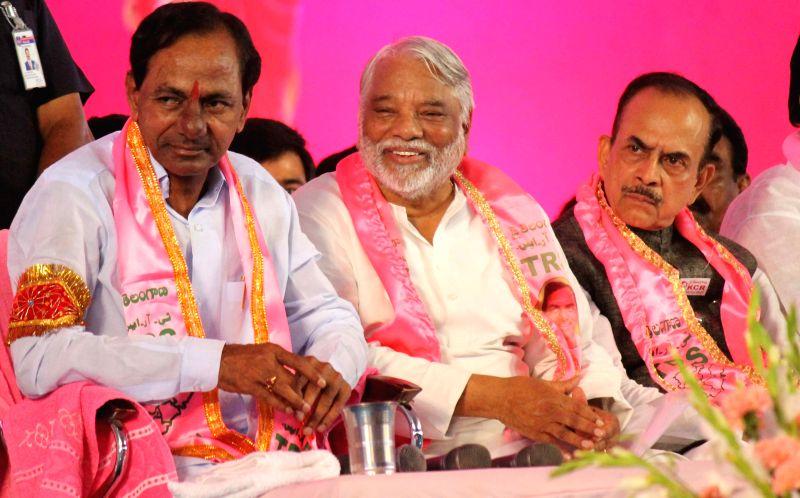 Telangana Chief Minister and Telangana Rashtra Samithi (TRS) chief K Chandrasekhar Rao, TRS Secretary General K Keshav Rao and others at TRS plenary in Hyderabad, on April 24, 2015. - K Chandrasekhar Rao