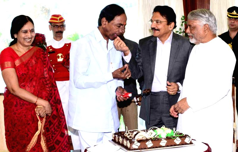 Telangana Chief Minister K Chandrasekhar Rao with Maharashtra Governor Chennamaneni Vidyasagar Rao, TRS general secretary K. Keshava Rao and others during his birthday celebrations in ... - K Chandrasekhar Rao, Chennamaneni Vidyasagar Rao and K. Keshava Rao