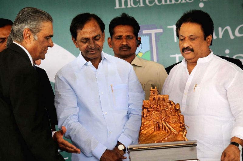 Telangana Chief Minister K Chandrasekhar Rao unveils the ​​Golconda Masters Golf Championship Trophy during a programme in Hyderabad on Feb 24, 2015. - K Chandrasekhar Rao