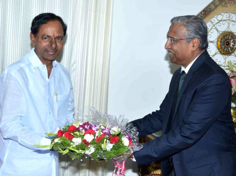Telangana Chief Minister K Chandrasekhar Rao with Insurance Regulatory and Development Authority Chairman T. S. Vijayan in Hyderabad, on April 6, 2015. - K Chandrasekhar Rao