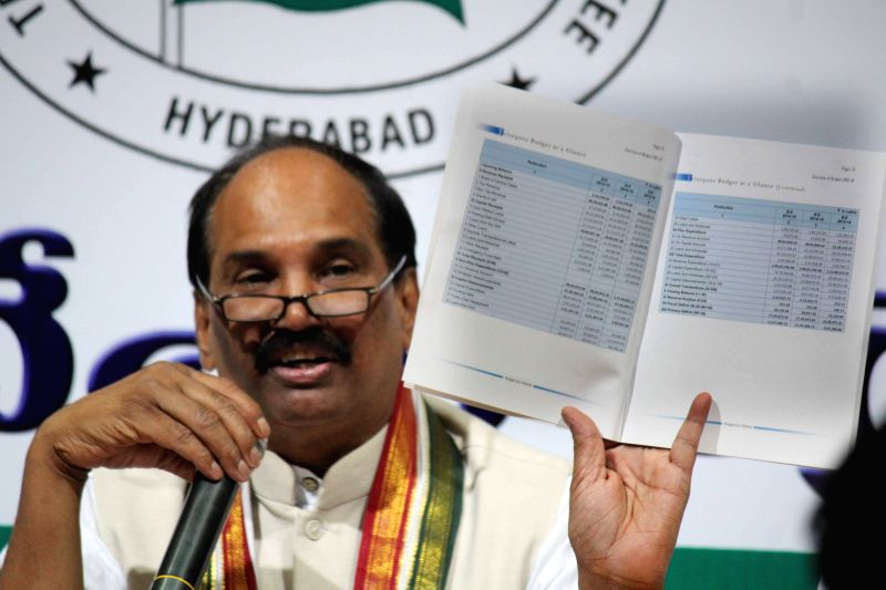 Telangana Congress chief N Uttam Kumar Reddy addresses a press conference regarding state budget 2015-16 in Hyderabad, on March 11, 2015.