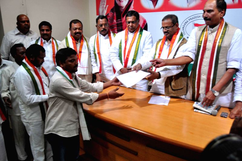 Telangana Congress leader K. Jana Reddy welcomes the new party members during a programme in Hyderabad on Feb 25, 2015.