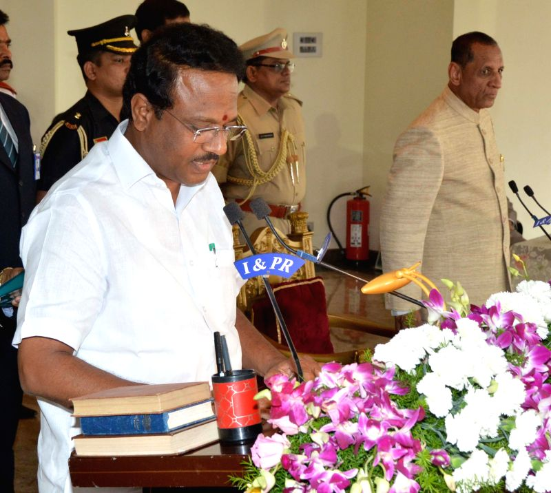 Telangana Governor E.S.L. Narasimhan Rao administers oath of office and secrecy to  C. Laxma Reddy as a Telangana Minister in Hyderabad, on Dec 16, 2014. - L. Narasimhan Rao and C. Laxma Reddy