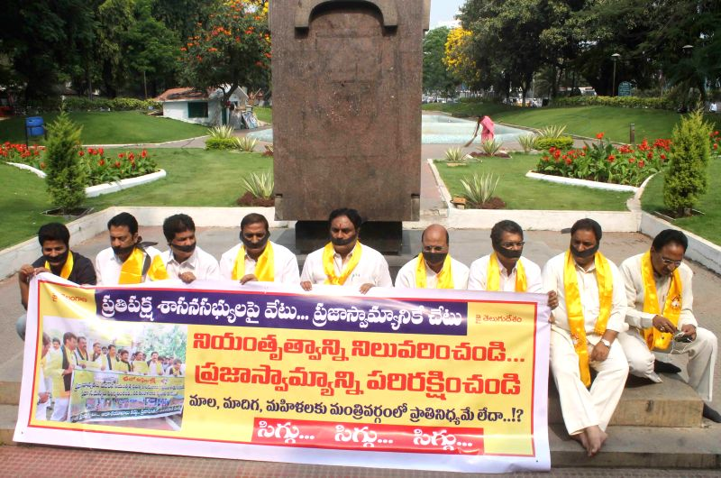 The TDP legislators who were suspended from the Telangana assembly for the entire budget session for disrupting the proceedings of the house stage a silent demonstration at Gun Park in ...