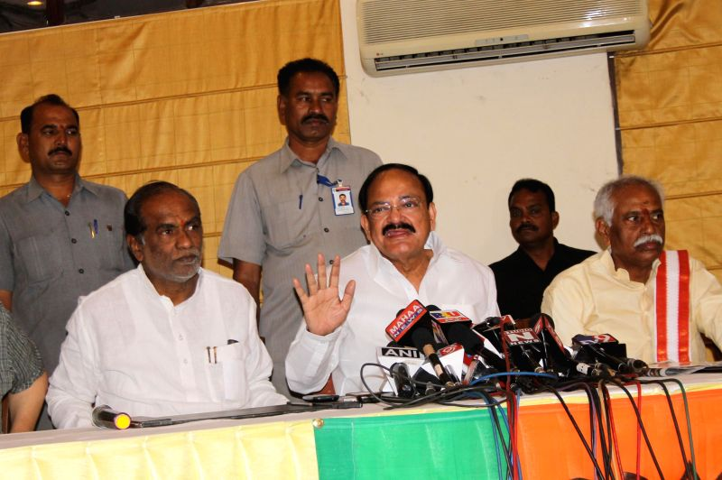 The Union Minister for Urban Development, Housing and Poverty Alleviation Venkaiah Naidu addresses a press conference in Hyderabad, on Dec 14, 2014. Also seen BJP MP from Secunderabad ... - Alleviation Venkaiah Naidu