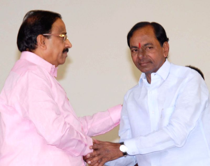 Tummala Nageswara Rao with Telangana Chief Minister K Chandrasekhar Rao after swearing-in as a Telangana Minister in Hyderabad, on Dec 16, 2014. - K Chandrasekhar Rao and Tummala Nageswara Rao