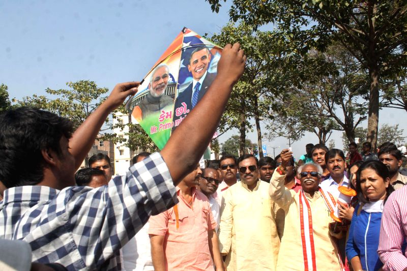 Union Minister of State for Labour and Employment (Independent Charge), Bandaru Dattatreya ​flies​ a kite​ depicting pictures of  Prime Minister Narendra Modi and US President Barack - Narendra Modi
