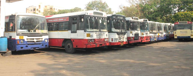 uses remain parked in their depot as Andhra Pradesh State Road Transport Corporation employees go on a strike in Hyderabad, on April 2, 2015.
