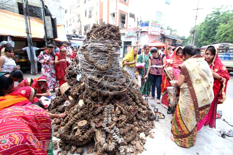 Women gather around a `holika` ahead of `Holika dahan`- burning of the devil on the eve of Holi in Hyderabad on March 5, 2015.
