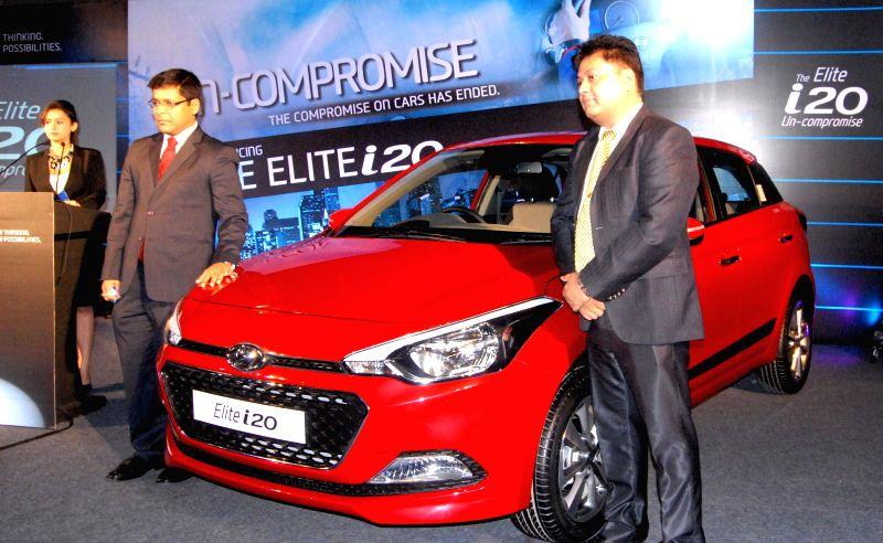 Hyundai Motor India Ltd Zonal Manager - East Tapan Kumar Ghosh launch `Hyundai i20` in Guwahati on Aug 19, 2014. - Tapan Kumar Ghosh