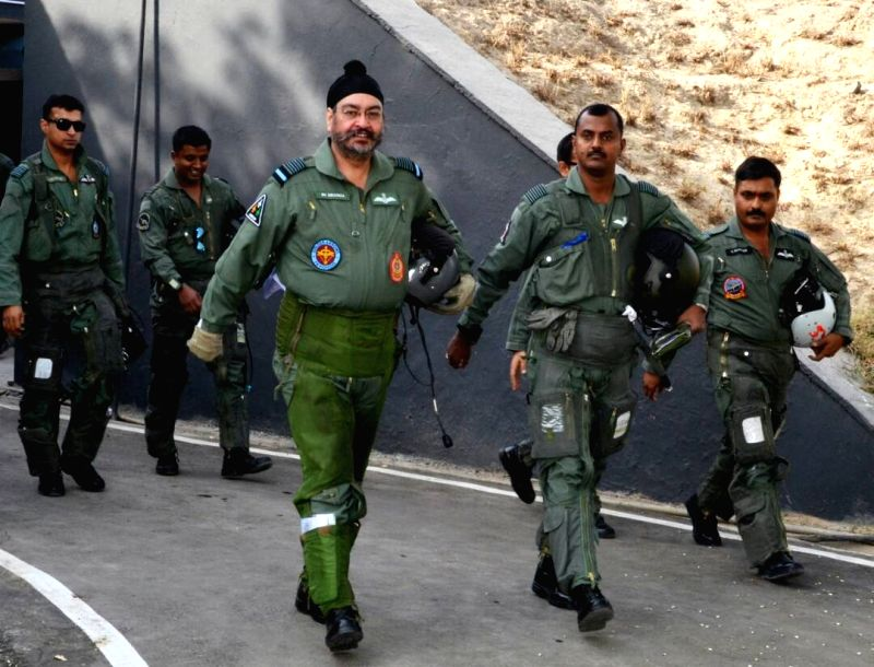 "IAF chief B.S. Dhanoa arrives to fly a MiG-21 at Air Force station in Bhisiana of Punjab's Bhatinda, ""to honour the valour and supreme sacrifice of Kargil martyrs"" on May 27, 2017."