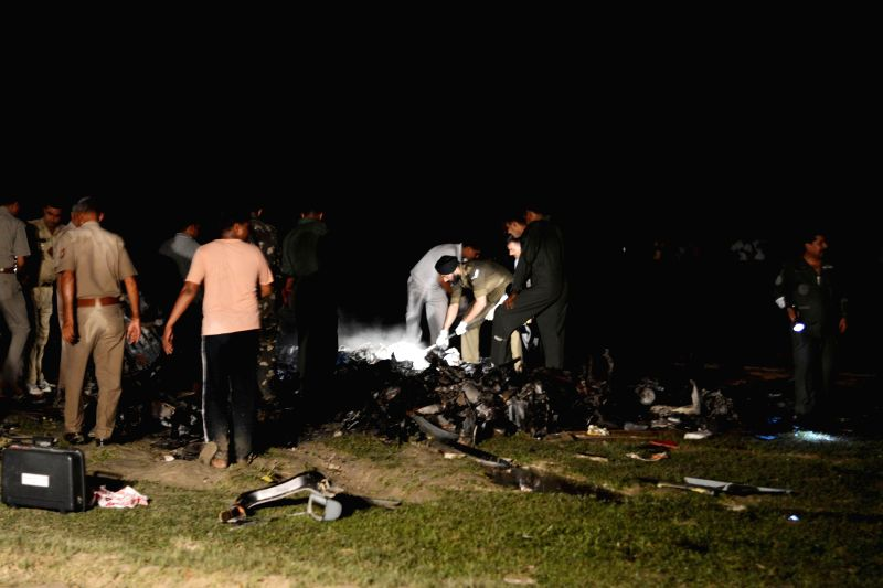 IAF personnel investigating the crash of the IAF helicopter at the crash site in Sitapur, Uttar Pradesh on JUly 25, 2014.