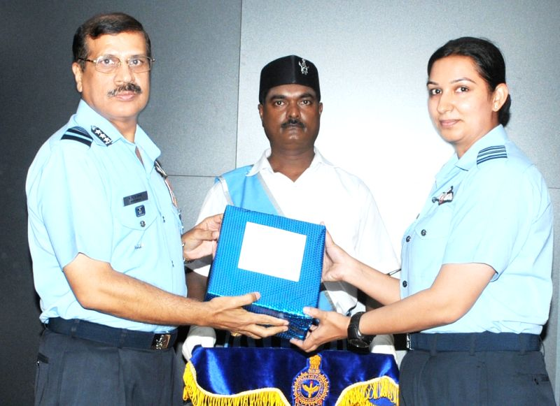"IAF Squadron leader Surbhi Arya being awarded the trophy for ""Best Aerial Bombing"" at Central Air Command in Allahabad on July 22, 2016."