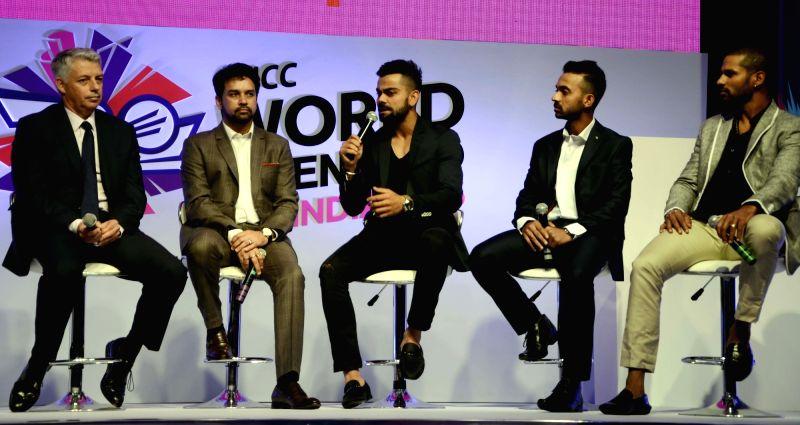 "ICC CEO Dave Richardson, BCCI Secretary Anurag Thakur, Virat Kohli, Shikhar Dhawan,  Ajinkya Rahane during a programme organised to unveil the trophy of ""ICC World Twenty20"" in ... - Shikhar Dhawan and Virat Kohli"