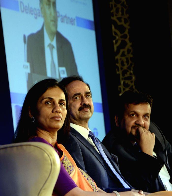 ICICI Bank chief Chanda Kochhar and CII Western Region Chairman and Kirloskar Brothers Ltd Chairman and Managing Director Sanjay Kirloskar addresses during the launch of a App `Travel Safe` ...