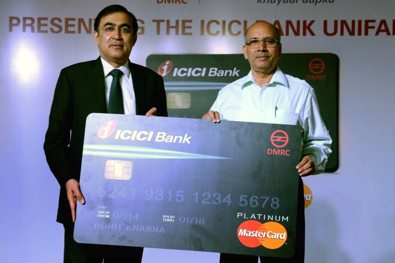 ICICI Bank ED Rajiv Sabharwal and DMRC MD Mangu Singh during launch of ICICI Unifare Card for Delhi metro commuters in New Delhi on June 25, 2014. - Mangu Singh