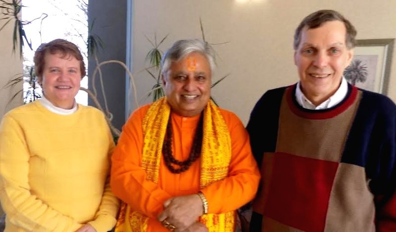 Idaho (US): The President of Universal Society of Hinduism Rajan Zed (center) with Boise Catholic Diocese Vicar General Joseph A. daSilva (right) and Chancellor Marcella M. Wilske (left) in Idaho, US ...