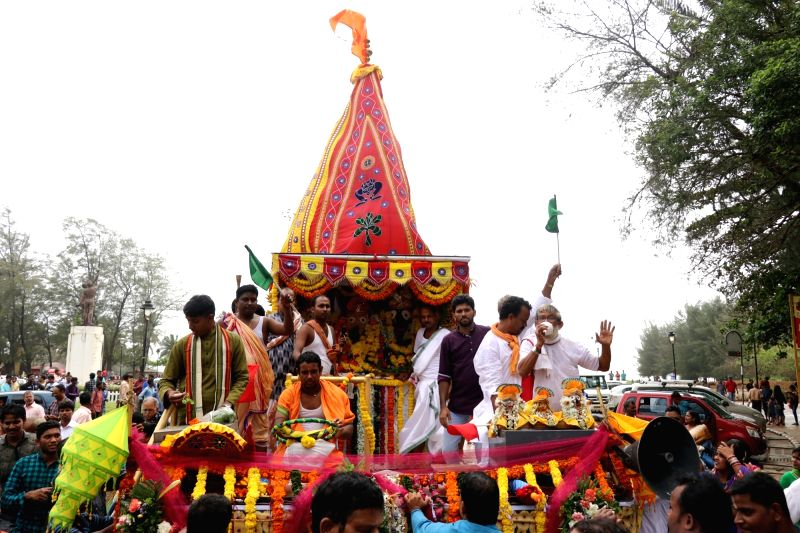 Idols of Lord Jagannath and his two siblingsLord Balaram and Goddess Subhadra being carried in a decorated chariot during Jagannath Rath Yatra, in Goa's Miramar on July 14, 2018.