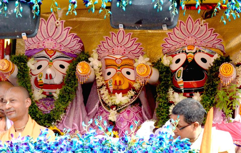 Idols of Lord Jagannath, Lord Balabhadra and Devi Subhadra kept on a chariot being pulled by devotees during Ulta RathYatra organised by International Society for Krishna Consciousness (ISKCON) in ...