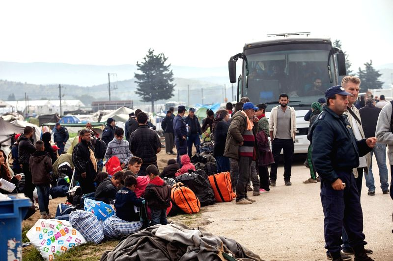 IDOMENI, May 24, 2016 - Refugees of Idomeni camp wait to be bused to other destinations at the border of Greece and Macedonia, May 24, 2016. The Greek government has stepped up efforts to gradually ...