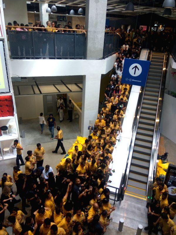 IKEA employees welcoming customers.