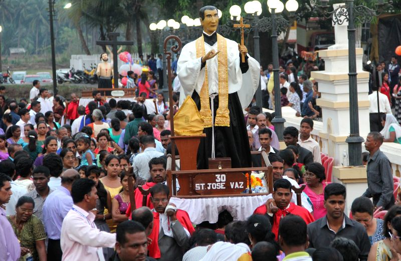 Devotees in large numbers participate in the famous Procession of Saints at Goa Velha, in Ilhas, Goa on March 23, 2015.