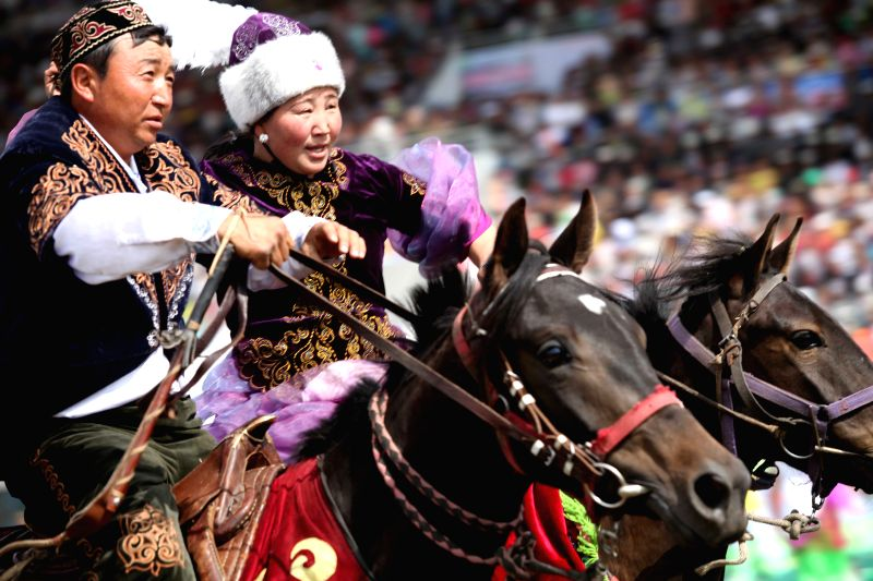 Equestrians stage a horse show during the opening ceremony of the 2014 China (Ili) Tianma International Tourism Festival in Zhaosu County of Ili, northwest China's ...