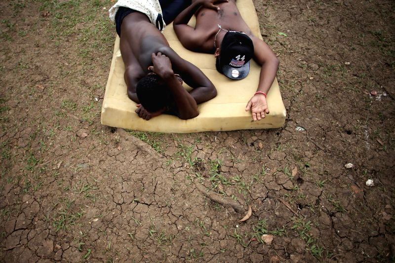 Illegal immigrants rest at a shelter in Meteti town, Darien province, Panama, on Aug. 5, 2015. So far in 2015, 11,418 immigrants have entered to Panama crossing by ...