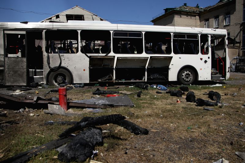 Photo taken on Sept. 3, 2014 shows a damaged bus left on a street in the aftermath of a fighting in Ilovaisk, Ukraine. At least 87 Ukrainian soldiers were killed ..