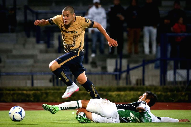 Image made for the Club Universidad Nacional A.C.(PUMAS), shows Pumas de la UNAM's Alan Acosta (UP), vying with Cafetaleros' Miguel Angel Cancela, during the ...