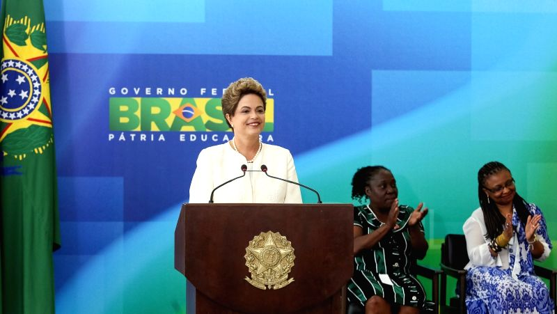 Image provided by Brasil's Presidency shows Brazilian President Dilma Rousseff (L) delivering a speech during a ceremony for the Black Awareness Day, in Brasilia, ...