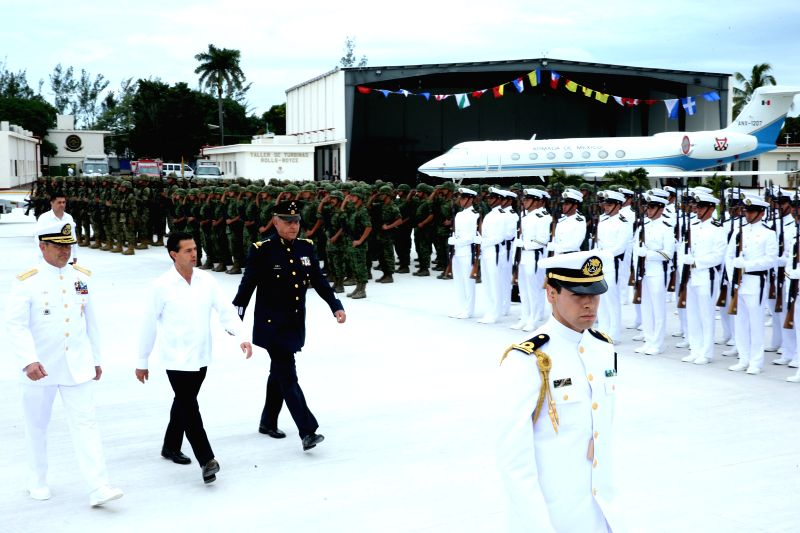 Image provided by Mexico's Presidency shows Mexican President Enrique Pena Nieto (2nd L) attending the commemoration of the Day of the Navy of Mexico, in Veracruz, ...