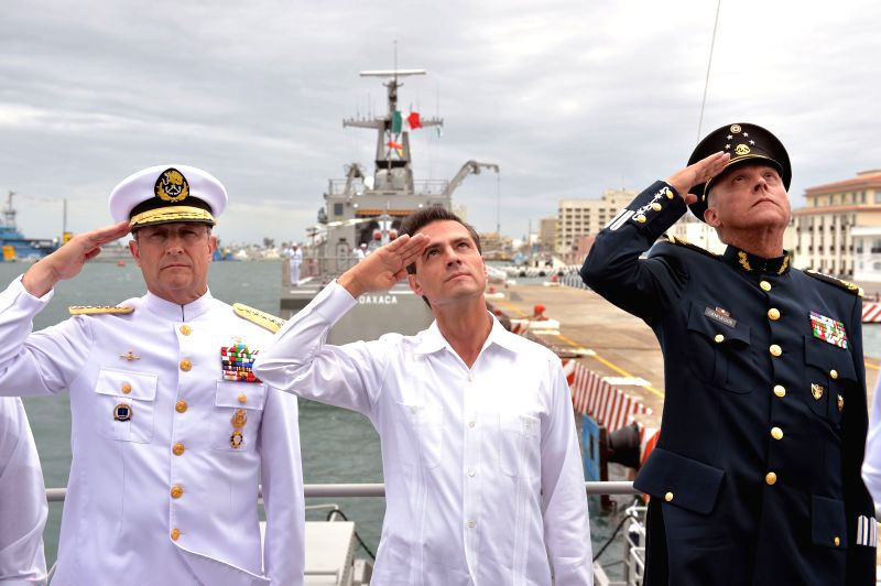 Image provided by Mexico's Presidency shows Mexican President Enrique Pena Nieto (C) attending the commemoration of the Day of the Navy of Mexico, in Veracruz, ...