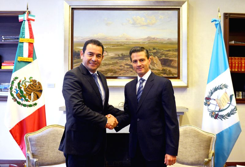 Image provided by Mexico's Presidency shows Mexican President Enrique Pena Nieto (R) shaking hands with Guatemala's President-elect Jimmy Morales (L) during ...