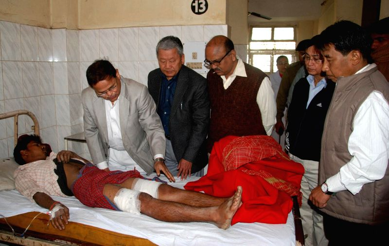 A man who was injured in a powerful blast that rocked Imphal, Manipur's capital city, being treated at Regional Institute of Medical Science and Hospital on Dec 21, 2014. Three people were ...